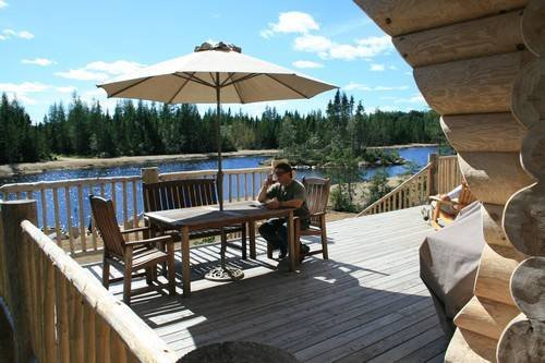 Luxury log cabin water view.